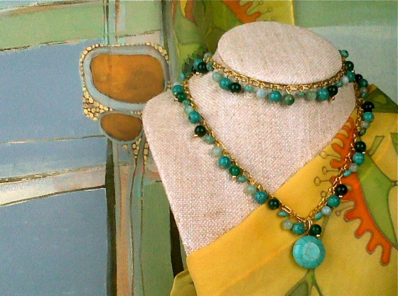 Jewelry from Amore by Grace Edwards is flanked by paintings and textiles